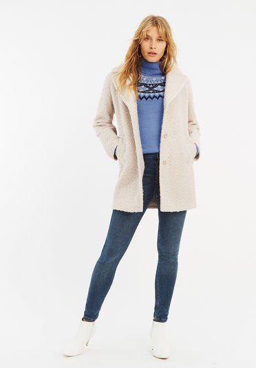 white fuzzy cardigan with sky blue printed mock-neck sweater