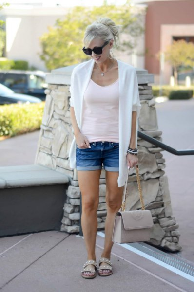 white knit sweater with a form-fitting tank top and shorts with a scoop neck