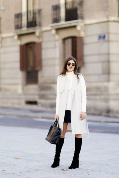 long white cardigan with imitation sweater and mini skirt