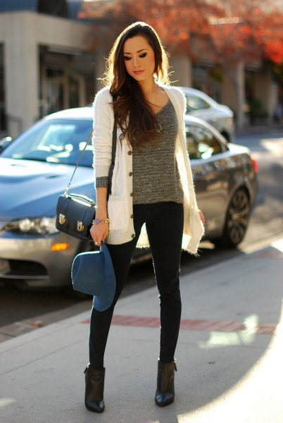 white cardigan with gray knitted sweater with scoop neck and black skinny jeans