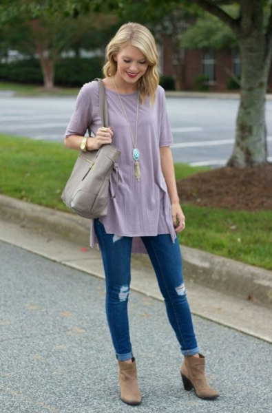 gray tunic t-shirt with blue skinny jeans with cuffs and brown suede boots