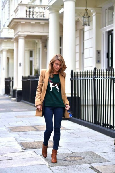 Long camel wool coat with dark blue skinny jeans and brown leather boots