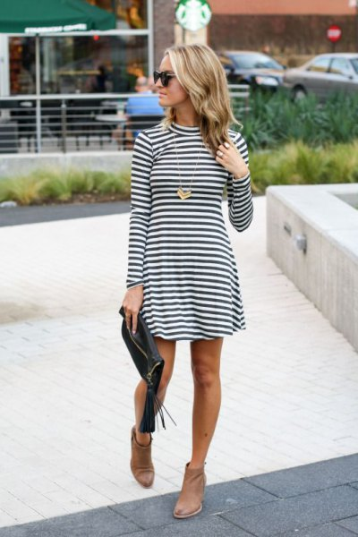 black and white striped mock neck fit and flare mini dress with brown leather ankle boots