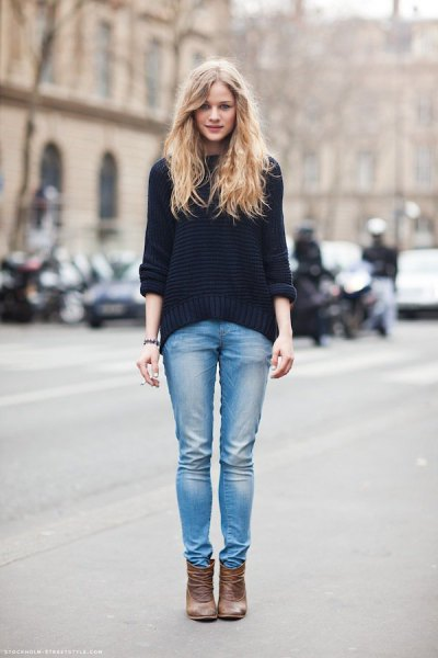 black, chunky sweater with light blue slim fit jeans and light brown leather boots