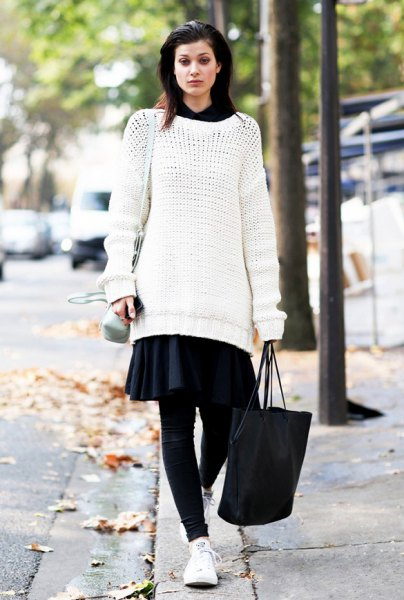 white tunic sweater with black miniskirt