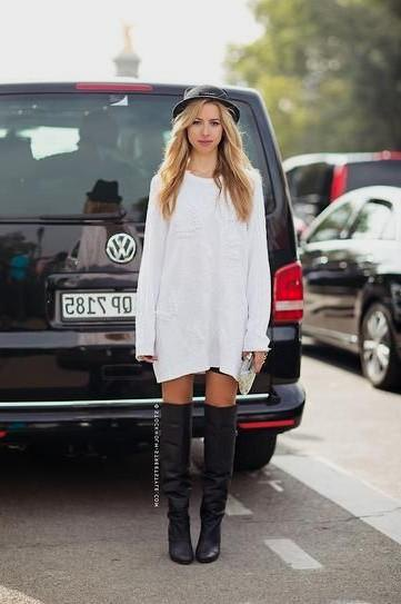 Sweater dress with black, thigh-high leather boots