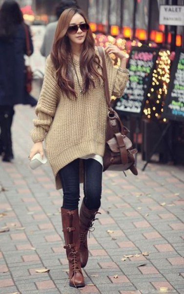 blush pink large sweater with navy skinny jeans and brown boots