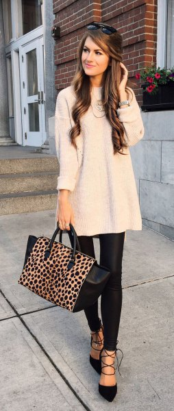 white ribbed large sweater with black leather leggings