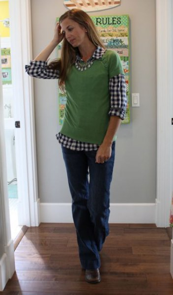 black and white checked shirt with green short-sleeved sweater