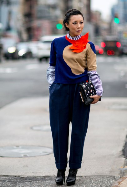 royal blue sweater with a striped shirt with a round collar and black trousers