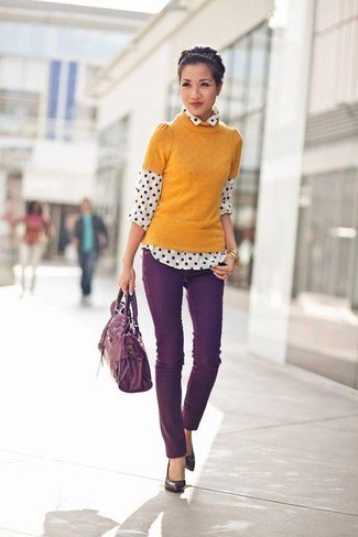 orange short-sleeved sweater with white and black polka dot shirt
