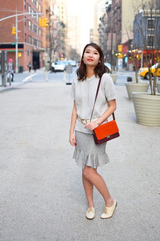 light gray sweater with matching knee-length skirt with frilled hem