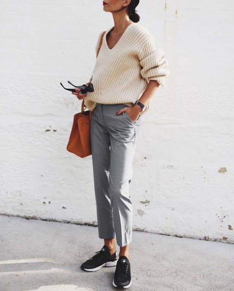 white rib sweater with V-neck and gray, short cut chinos
