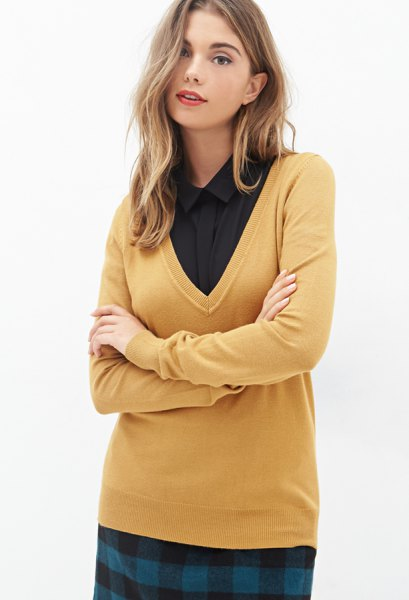 mustard yellow sweater with V-neck and black shirt with buttons