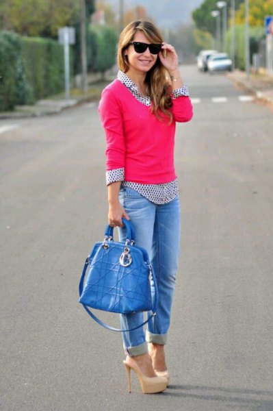 pink knit sweater with black and white polka dot shirt and jeans with cuffs