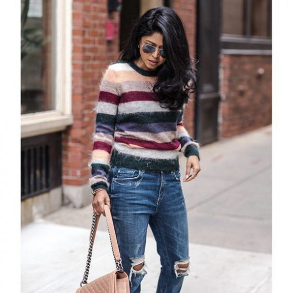 white pink and black striped sweater with destroyed jeans