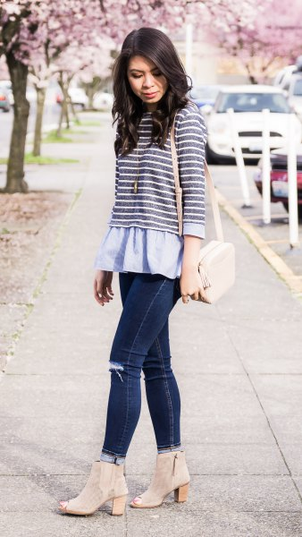 gray and white striped top over light blue peplum blouse
