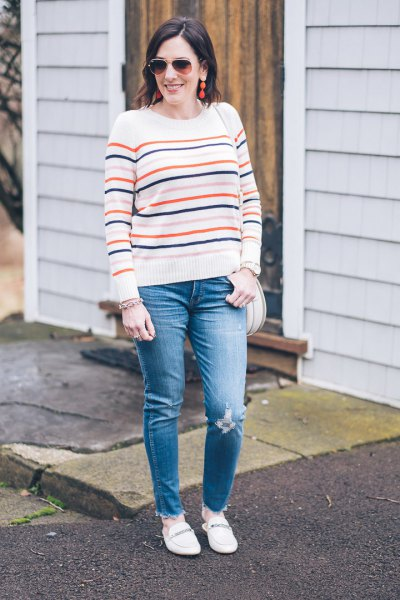 white knitted sweater with blue jeans and loafers