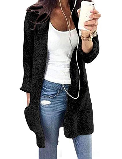 white, form-fitting tank top with scoop neck and black longline cardigan sweater