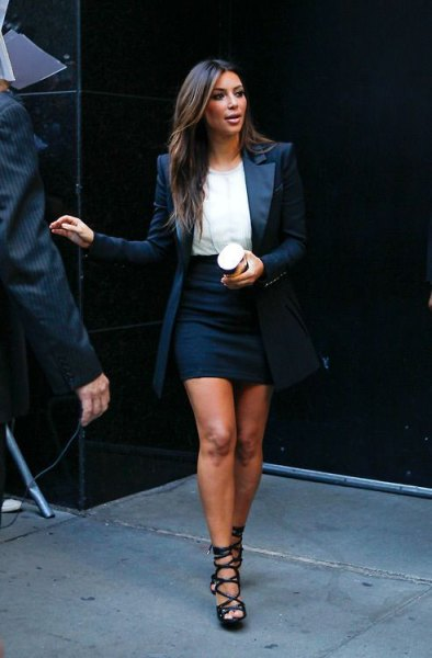 white chiffon blouse with black, form-fitting mini skirt