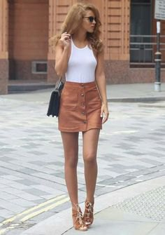white tank top with light brown suede mini skirt with buttons