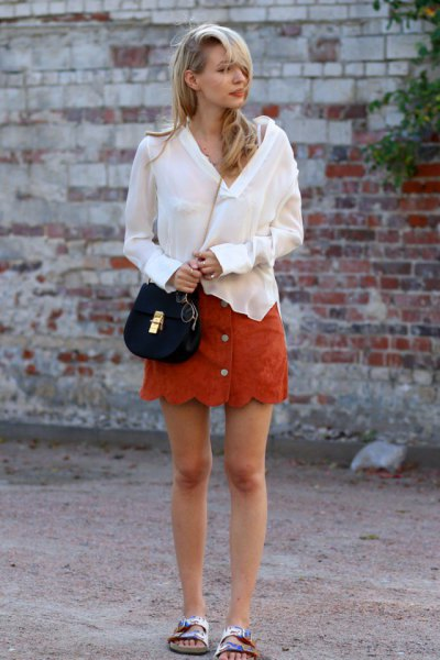 orange scalloped hem button mini skirt made of suede with white blouse