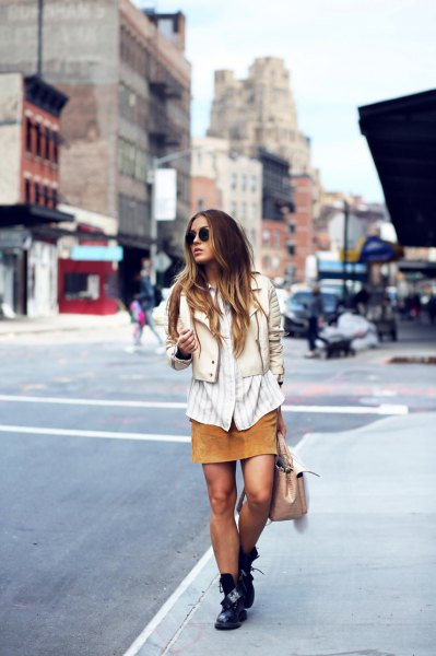 white and gray vertical striped shirt with light pink tailored vest and orange skirt