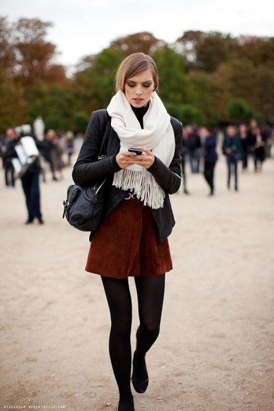 black blazer with white fringed scarf and mini skirt