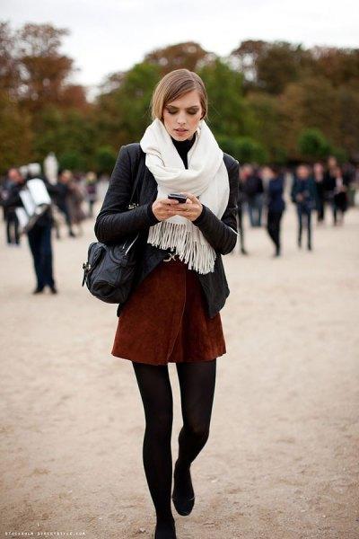 black blazer with white fringed scarf and mini skirt
