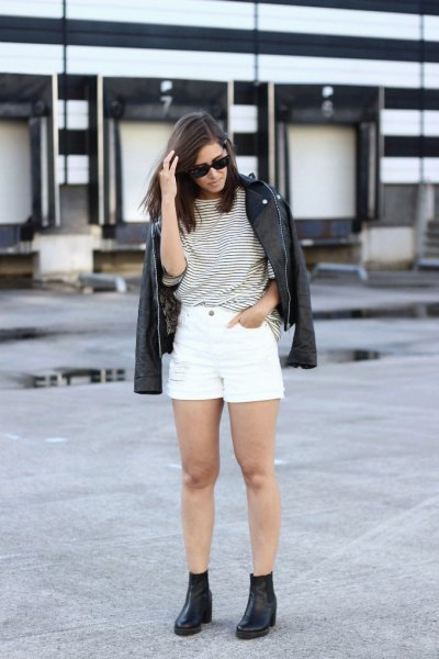 black and white striped t-shirt with denim shorts and leather jackets