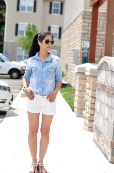 light blue chambray shirt with buttons and white denim shorts