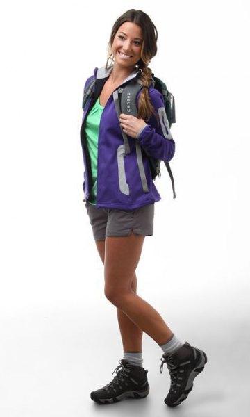 blue hiking jacket with light gray mini shorts