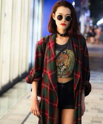 red oversized checkered flannel shirt with shortened black t-shirt and denim shorts