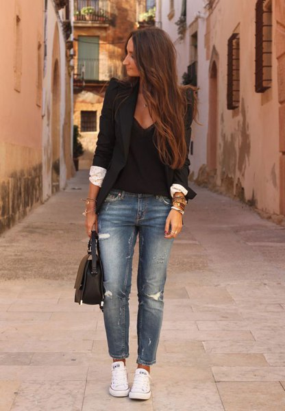 black blazer with deep v-neck blouse and blue torn jeans