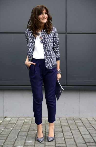 black and white printed blazer with white blouse and cropped navy pants