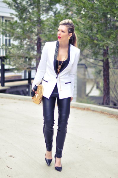 white and black blazer with narrow leather pants