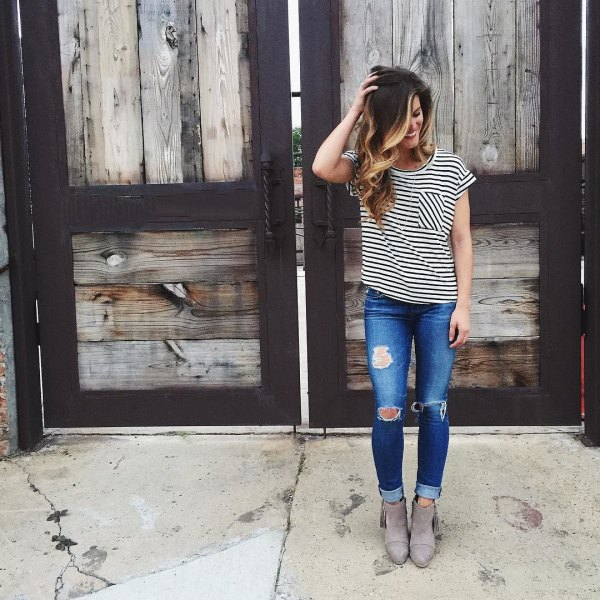 black and white striped t-shirt with torn skinny jeans and suede boots