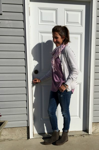 white and black polka dot cardigan with gray blouse and ankle boots