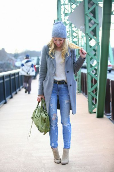 gray longline wool coat with light blue, torn slim fit jeans