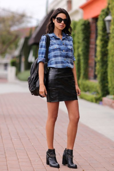 blue plaid shirt with black leather mini skirt and leather boots