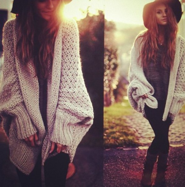 white, chunky cardigan with black floppy hat