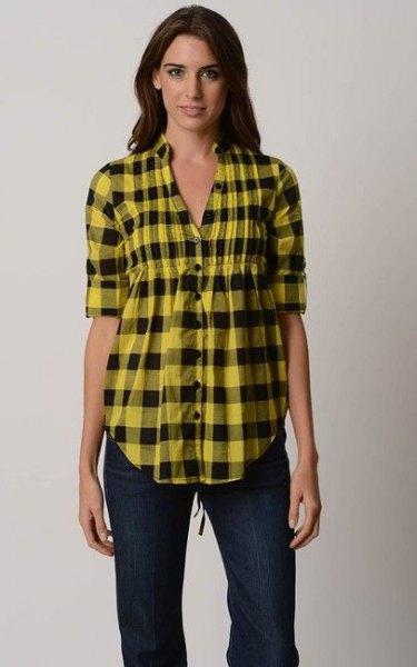 yellow-black checkered peplum shirt with dark skinny jeans