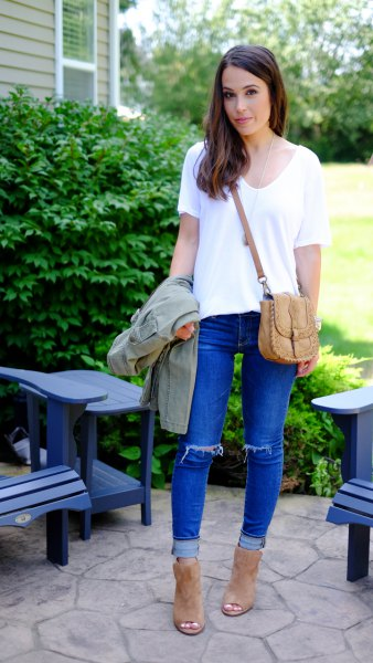 white t-shirt with v-neck and blue torn jeans with cuff