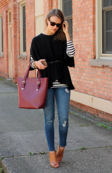 black wide-sleeved sweater over striped long-sleeved T-shirt