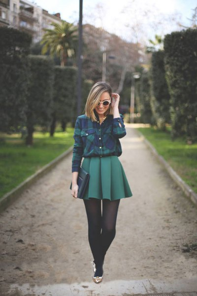 blue-green checked shirt with mini gray pleated skirt