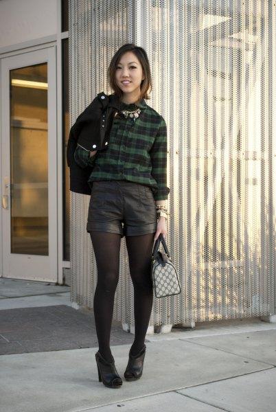 plaid shirt with black mini shorts and leggings