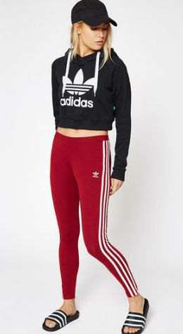 black graphic short cut hoodie with baseball cap and red and white striped leggings