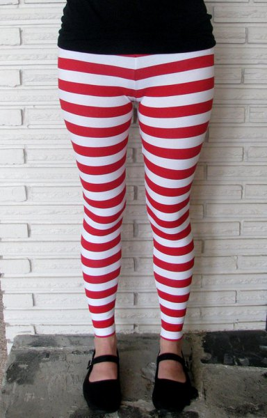 black t-shirt with red and white striped leggings and loafers