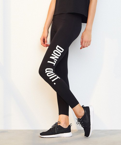 black tank top with printed leggings and sneakers