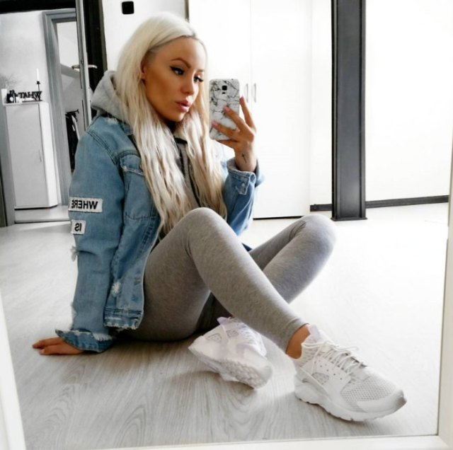 blue denim jacket with light gray leggings and running shoes
